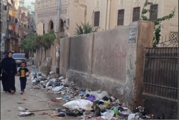 صور| القمامة تهدد صحة أهالي شارع سعد زغلول في